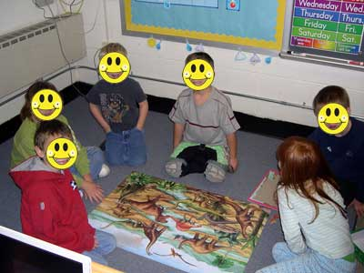Kids doing floor puzzle